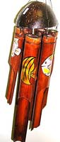 Dark brown bamboo windchime with assorted color and design fish painted on each pipe, oval half nut shell on top