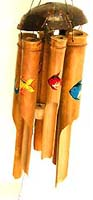 Light brown bamboo wind chime with assorted color and design fish, flat half nut shell on top