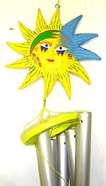 Wood carving yellow and blue sun face with metal windchime