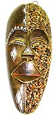 wooden masks of Bali, handcrafted batik fabic on top