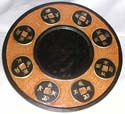 Orange tan crack rounded mirror with multi oriental coin pattern design