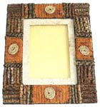 Large rectangular wooden photo frame with swirling pattern decor around edge