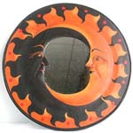 Rounded two-moon (black and tan color) wooden mirror