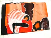 Beautiful wholesale apparel collection, African art figure design on red and orange batik shawl wrap