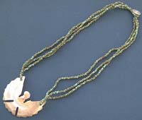 Fashion necklace with an eagle seashell pendant decor in triple green beaded string design, button loop for convenience closure