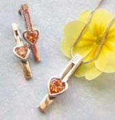 Cz jewelry supplier presenting chain necklace, orange cz heart love long strip pendant and stud earring set