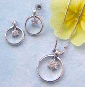 Wholesale floral jewelry online shop offering chain necklace, clear cz flower in circle pendant and stud earring set