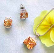 Costume importer jewelry wholesale chain necklace, rectangular orange cz pendant and stud earring set